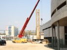 Tower crane grows at the construction site of KCB