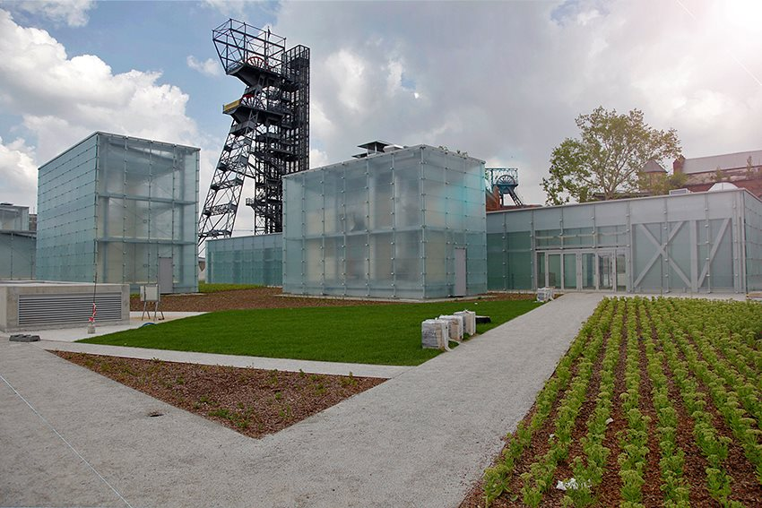 "© Silesian Museum, glass cuboids and the ""Warszawa"" mine shaft at the background"